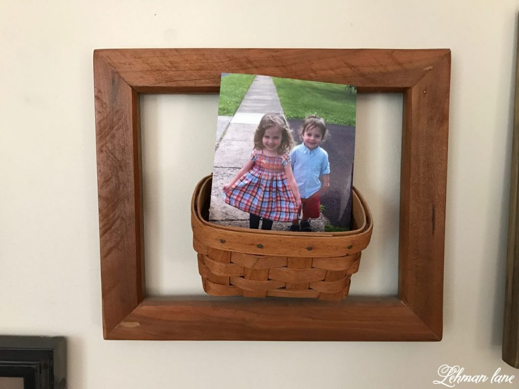 Creating a Gallery Wall - basket of photos and wooden picture frame