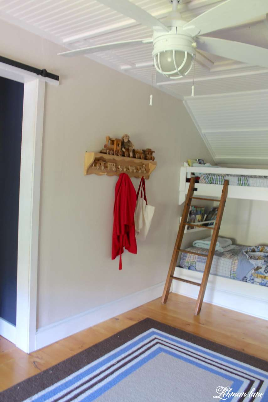 From Closet to boys bedroom.  We added built in bunk beds, window seat and bookcases and pallet sliding barn door!