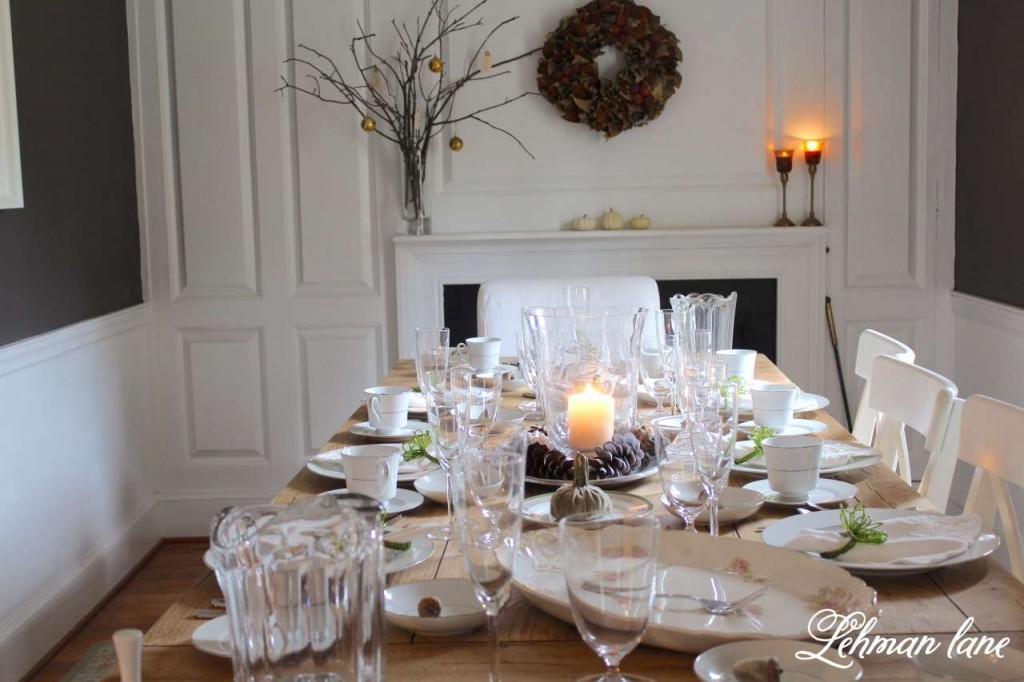 Thanksgiving tablescape, white dishes, farm table, clear glass, green napkin rings, farmhouse