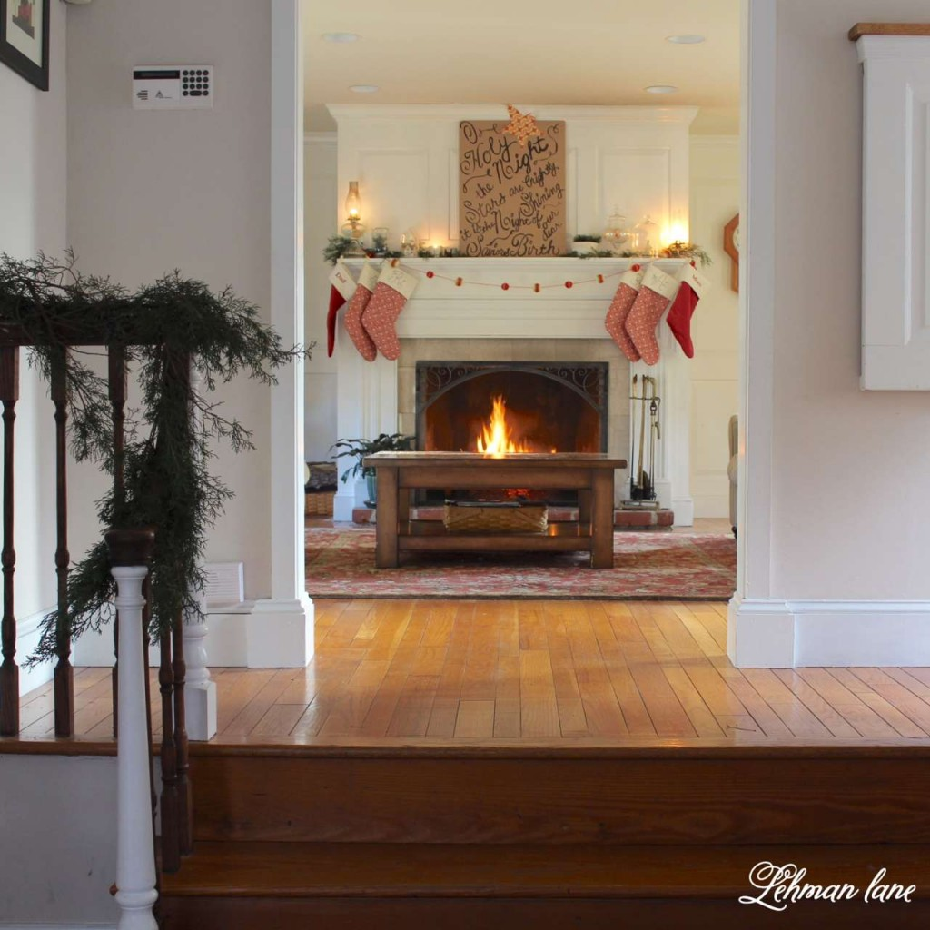 Christmas Home Tour 2015 O Holy night red stockings fireplace greens stairs