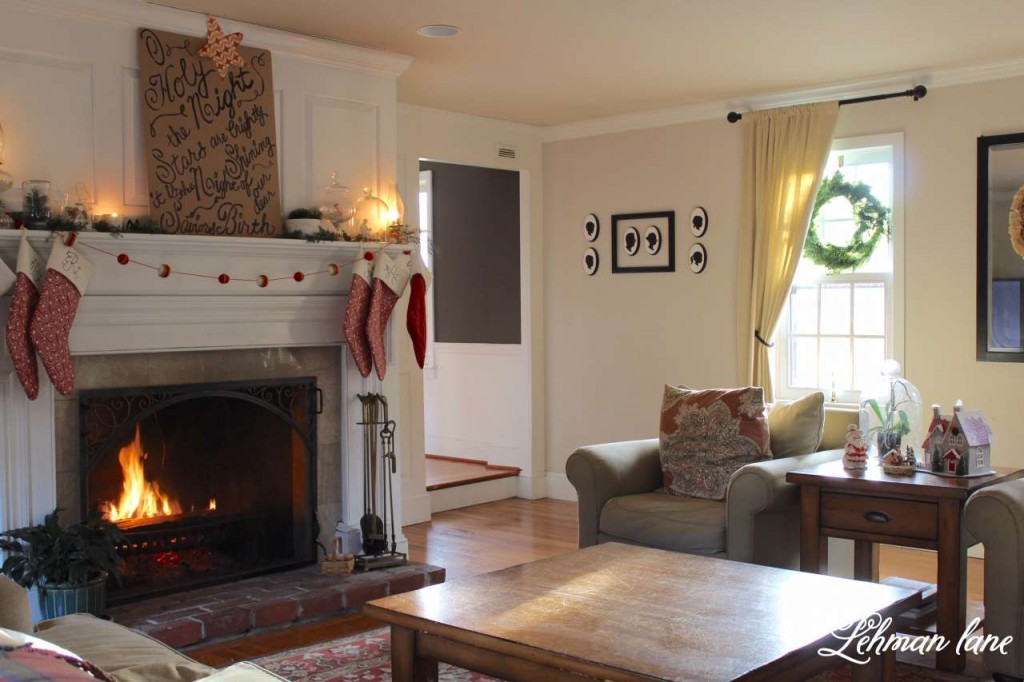 Christmas Home Tour 2015 O Holy night red stockings fireplace greens living room