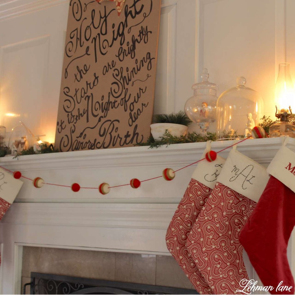 Christmas Home Tour 2015 O Holy night red stockings fireplace greens cloche glass candle lantern