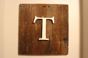 letter sign with old wood as a backdrop