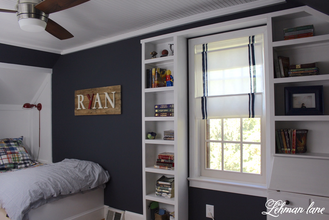 DIY - Pottery Barn Inspired Striped Roman Shade - Final Reveal - Boys Farmhouse Bedroom, Built in bed, dresser, bead board ceiling, wide pine floors, Benjamin Moore Hale Navy walls, and an angled door