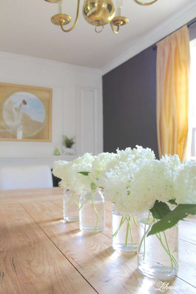 farmhouse summer tour - dinning room - white hydrangeas in mason jars