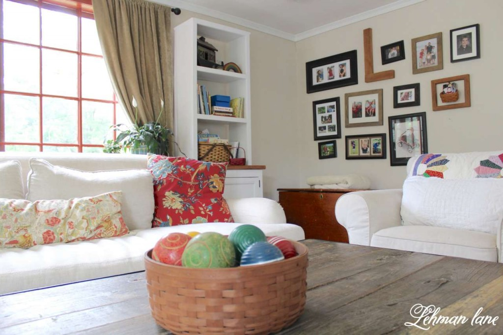 farmhouse summer tour - family room - gallery wall