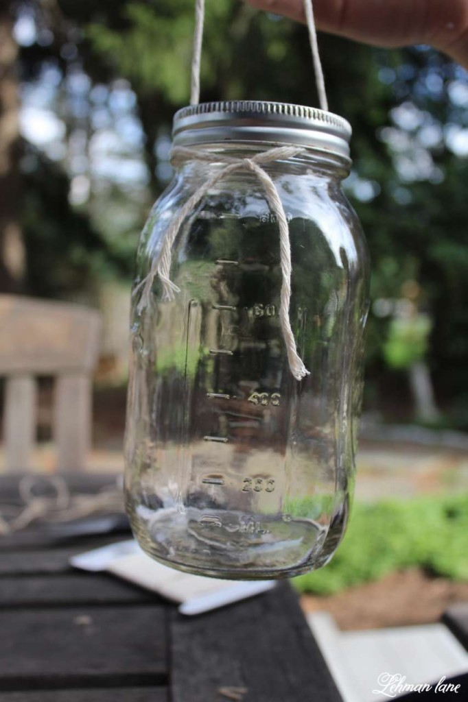 Learn how to make a super simple DIY mason or ball jar lantern using supplies you probably already have at home! Video of the DIY too! #diy #crafts #masonjarcrafts #masonjars #lanterns http://lehmanlane.net