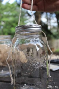 How to Make a super simple mason jar lantern using supplies you probably already have at home and a video! #masonjarcrafts #masonjar #ba;lljar http://lehmanlane.net
