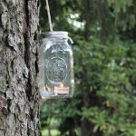 Learn how to make a Mason Jar Lantern in under a minute with simple supplies you have at home perfect for a nighttime summer garden party.