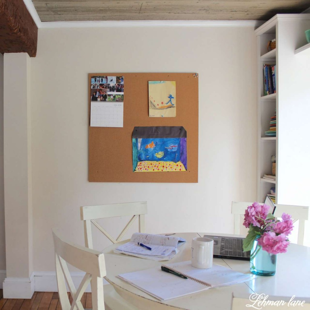 Homework station in the kitchen and DIY cork board for hanging all our kids artwork