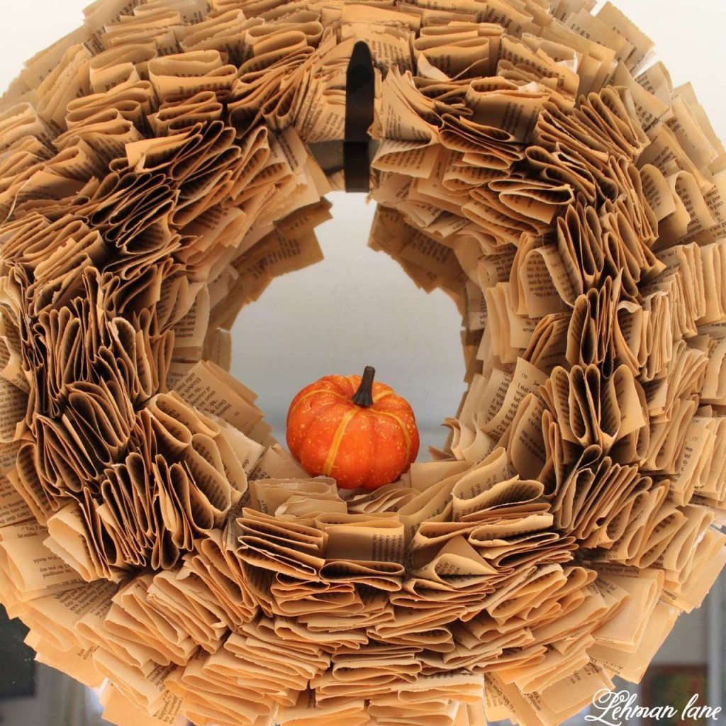 v - book page wreath with a pumpkin