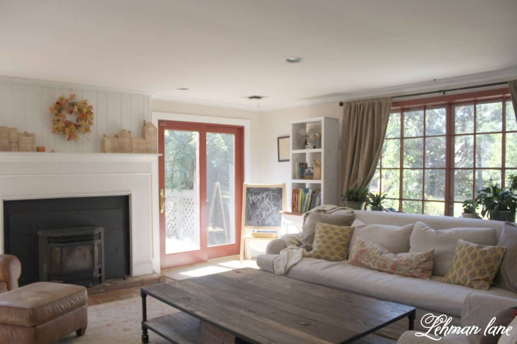 Stop by to see how we decorate our farmhouse for fall - family room fireplace and sofa