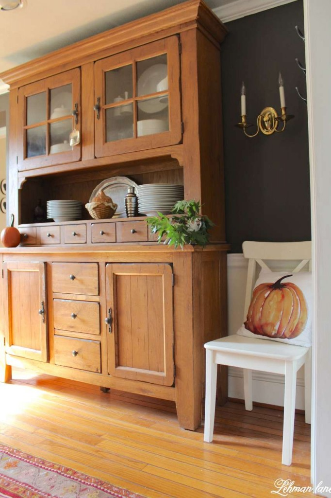 Stop by to see how we decorate our farmhouse for fall - dining room hutch and pumpkin pillow