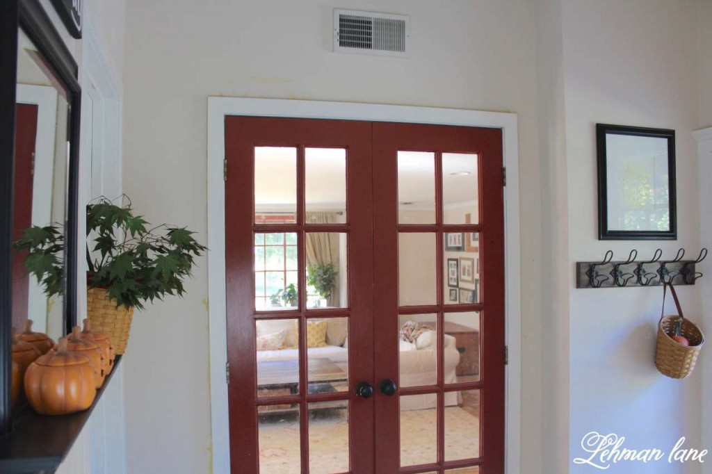 Stop by to see how we decorate our farmhouse for fall - red french doors in our entryway