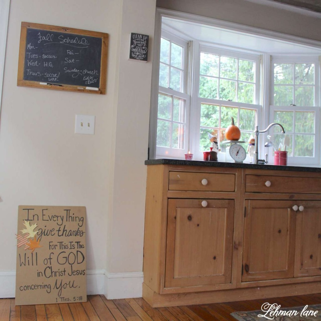 Stop by to see how we decorate our farmhouse for fall - kitchen bay window and sink, chalkboard and fall sign