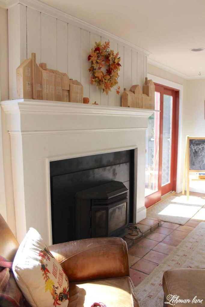 Stop by to see how we decorate our farmhouse for fall - family room fireplace mantel and leather chair