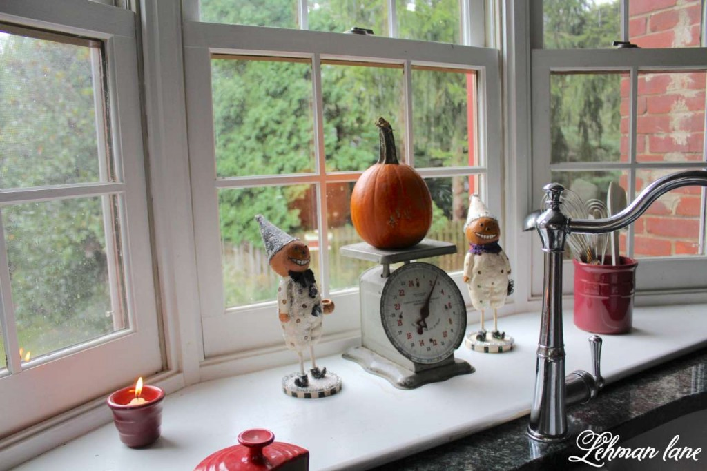 Stop by to see how we decorate our farmhouse for fall - kitchen scale pumpkin in window