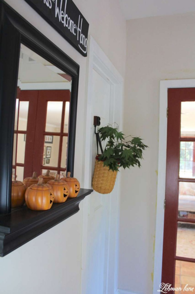 Stop by to see how we decorate our farmhouse for fall - pumpkin tealights and fall leaves in basket
