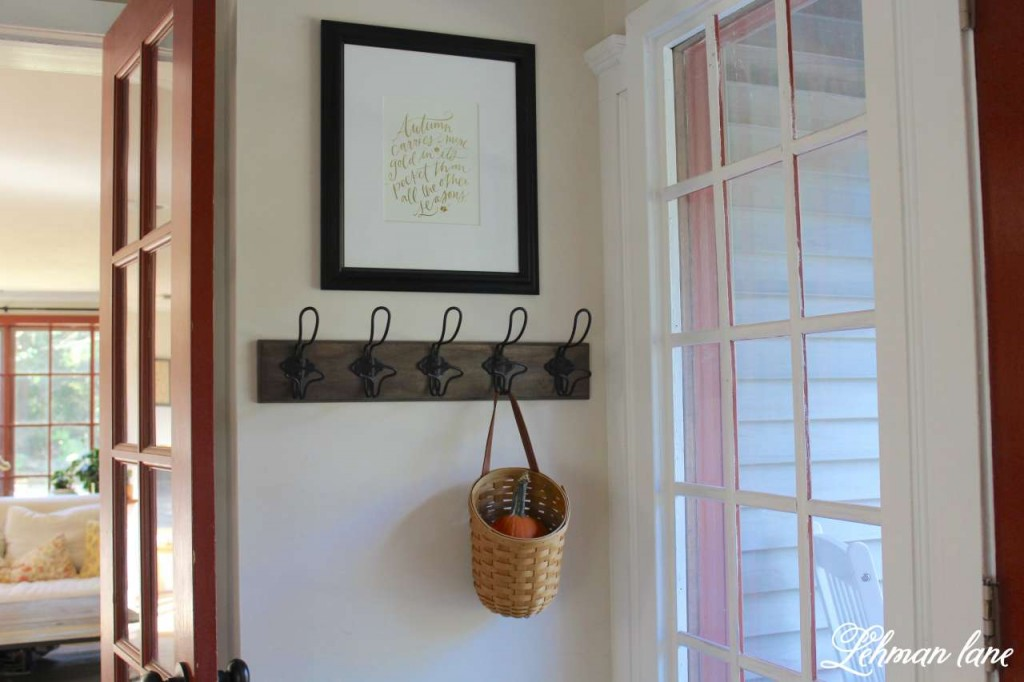Stop by to see how we decorate our farmhouse for fall - entryway with hooks and autumn quote