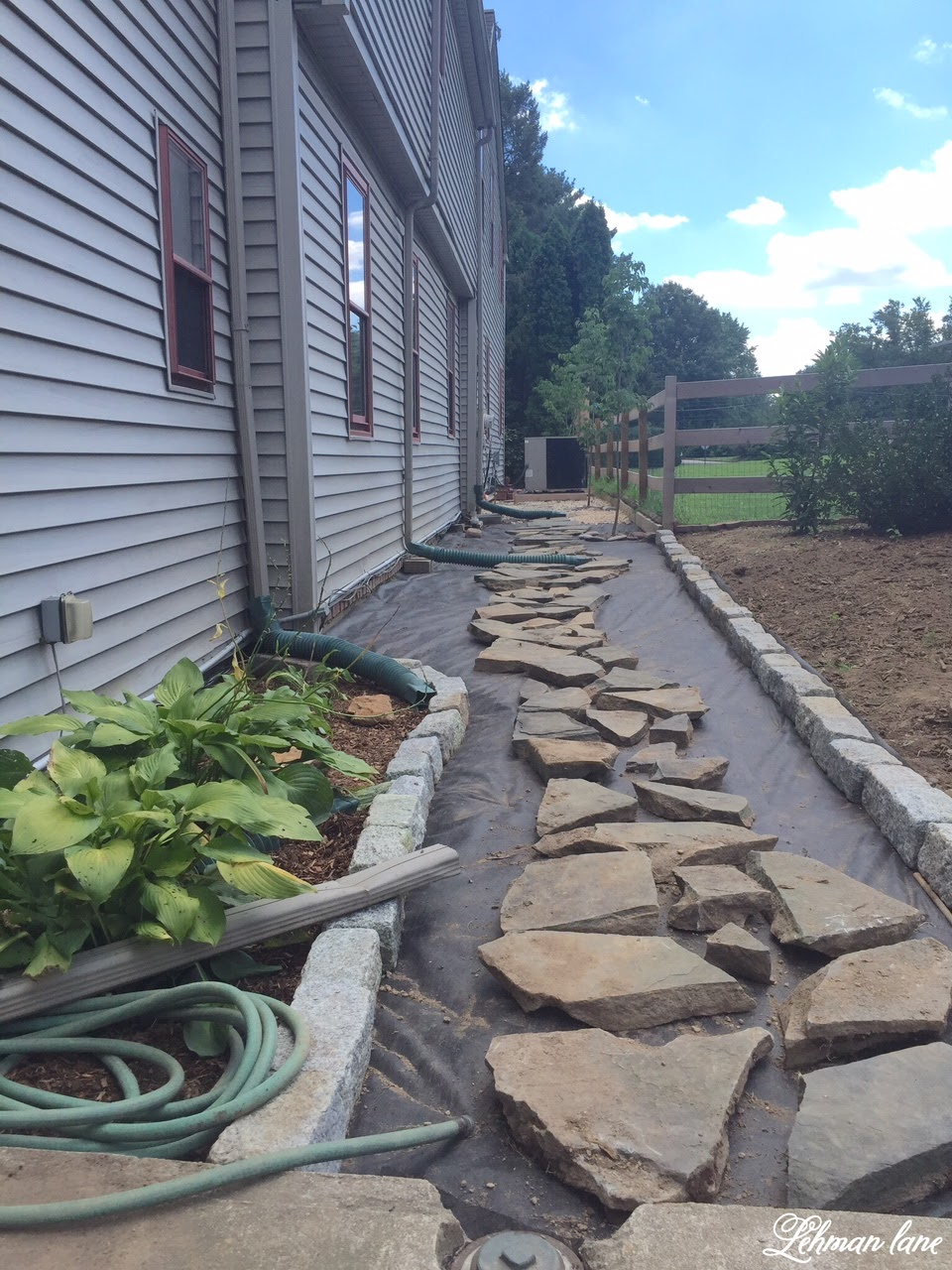 landscape fabricand flagstone stepping stones