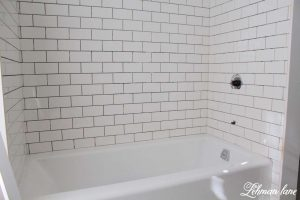 How to Move a Cast Iron Bathtub - Tub with White Subway Tile Renovation