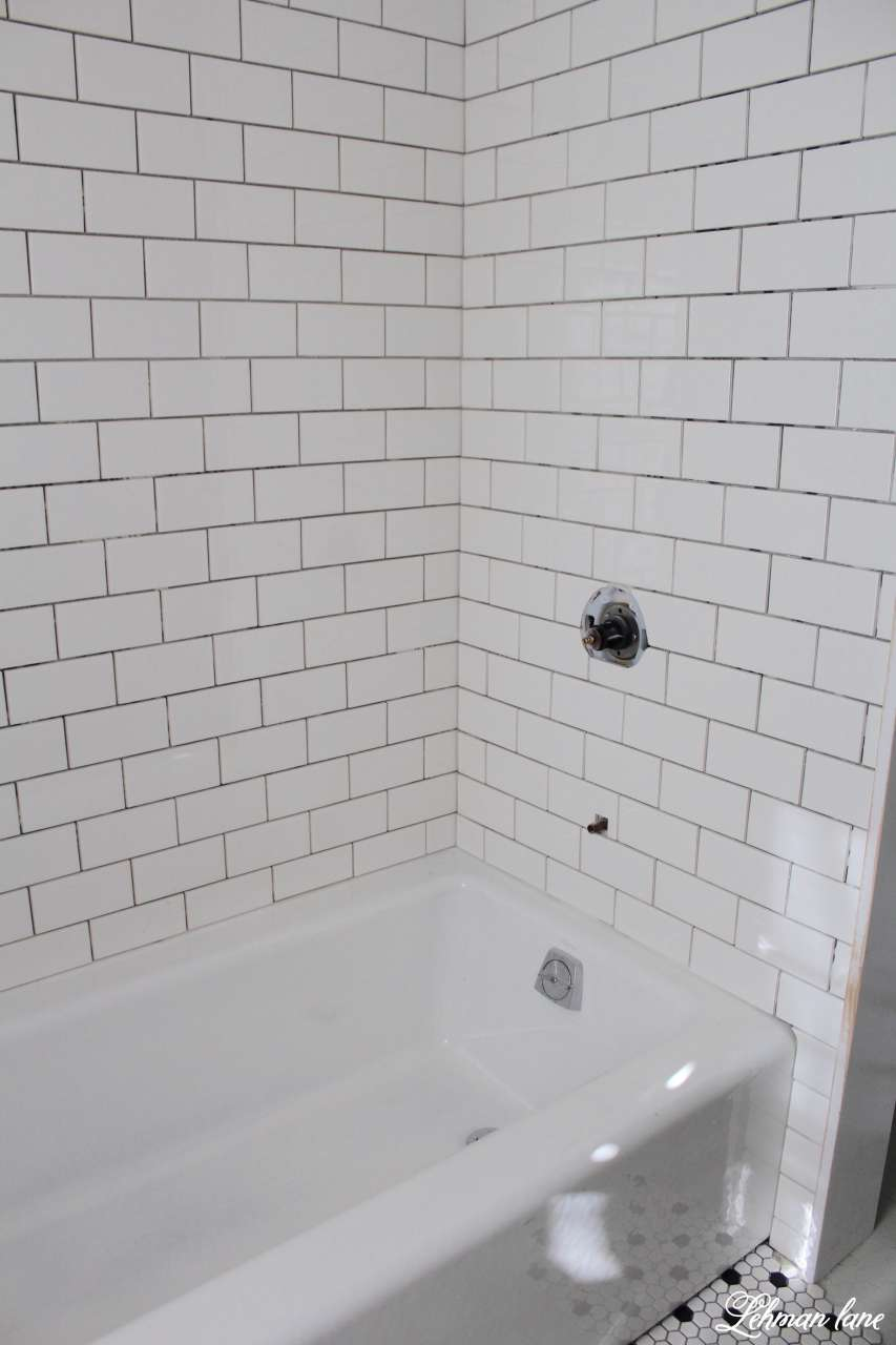 White subway tile tub surround