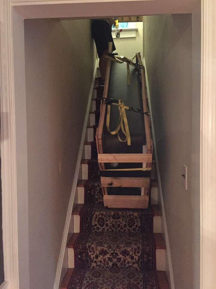 How to Move a Cast Iron Bathtub - Tub hanging in the Stairway