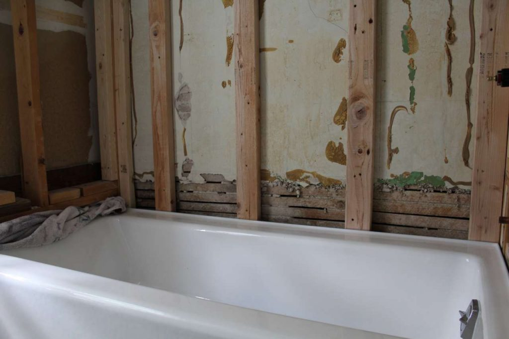 How to Move a Cast Iron Bathtub - Tub in Boys Bathroom Renovation