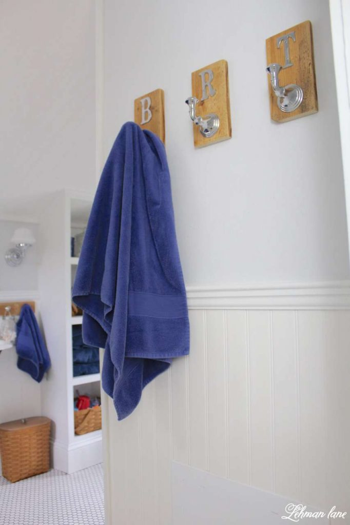We created 2 DIY pallet towel racks for our boys bathroom