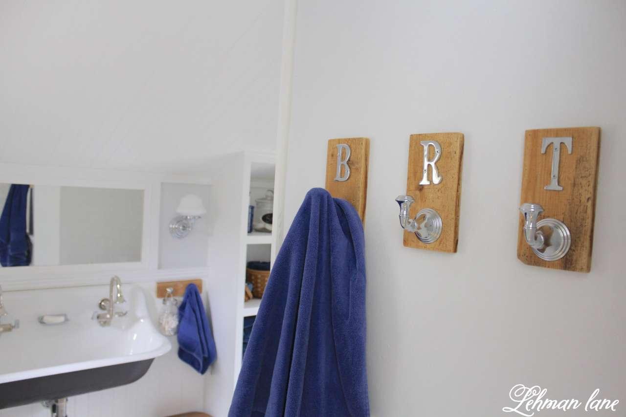 We created 2 DIY pallet towel racks for our boys bathroom