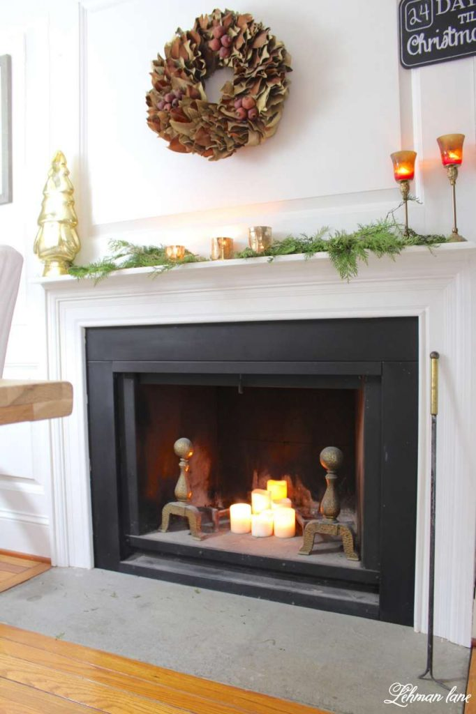 A Very Farmhouse Christmas Home Tour - fireplace mantel dining room