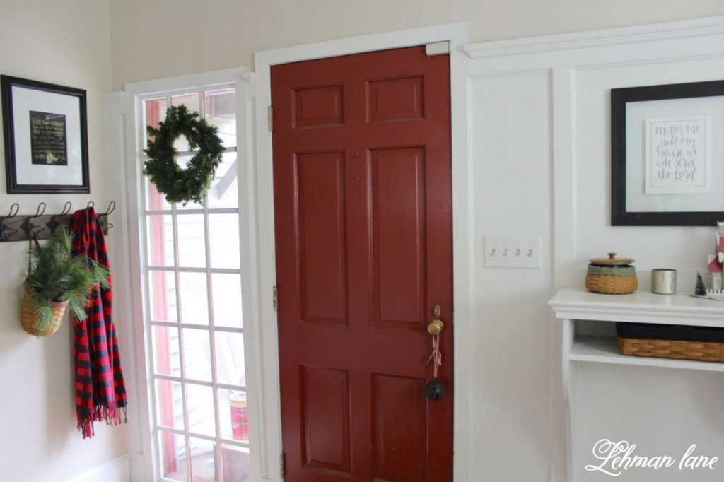 A Very Farmhouse Christmas Home Tour - entryway - red door