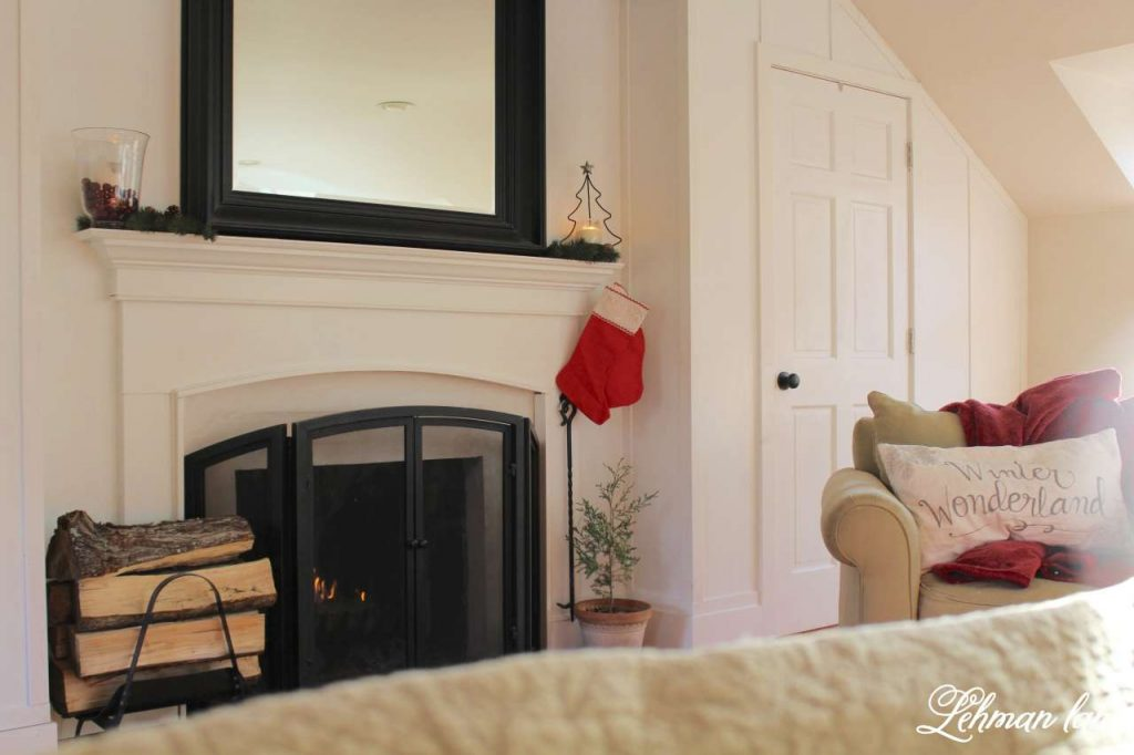 A Very Farmhouse Christmas Home Tour - master bedroom fireplace