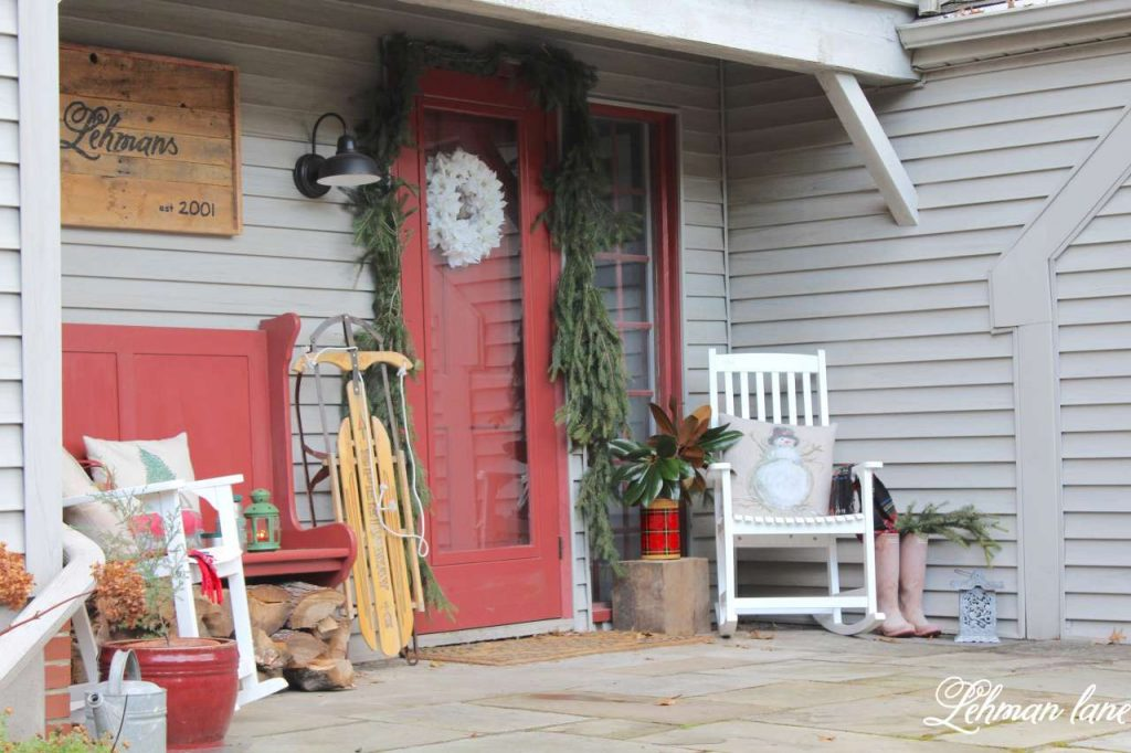 Christmas Front Porch - red bench, white rockers, farmhouse