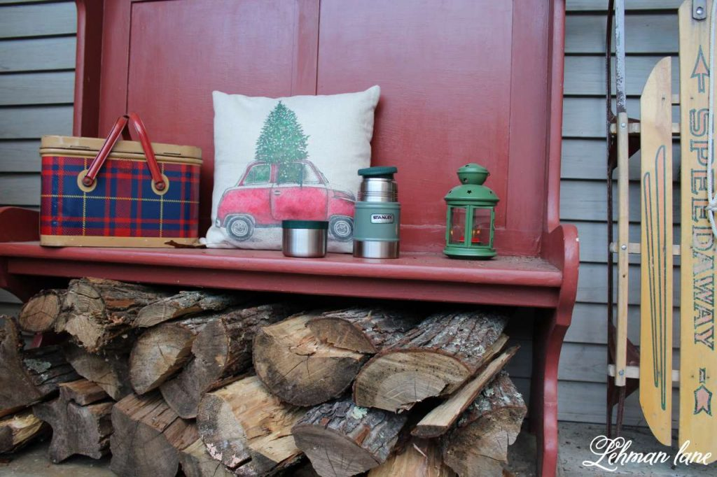 Christmas Front Porch - red bench, tartan lunch box, car pillow
