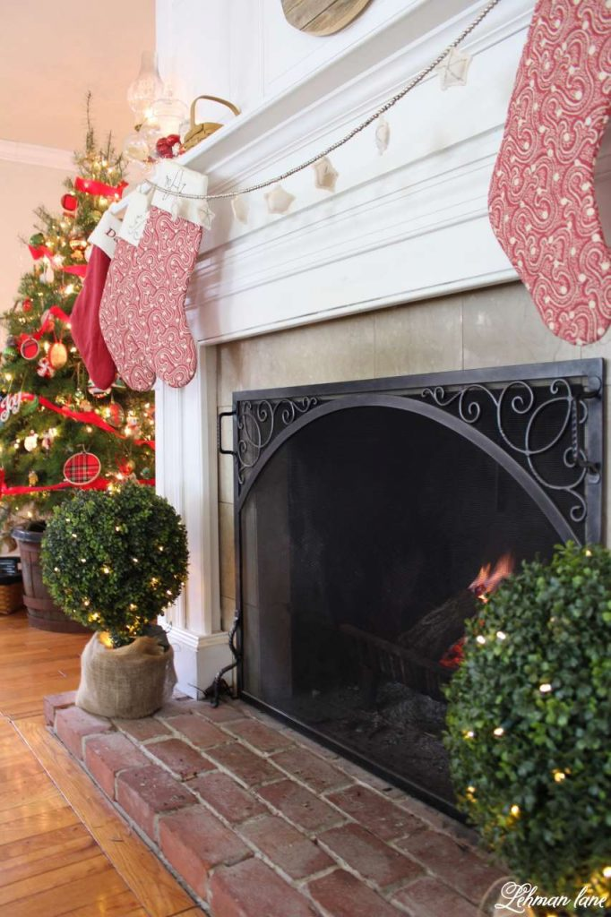Christmas Living Room - Very Merry Christmas Tour - balsam hill boxwood topiaries and red stockings