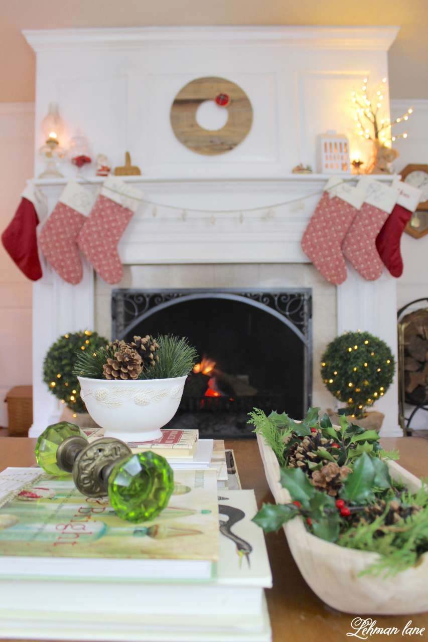 Christmas Living Room - Very Merry Christmas Tour - fireplace and evergreens on the coffee table