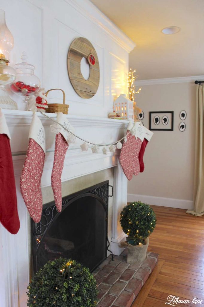 Christmas Living Room - Very Merry Christmas Tour - fireplace mantel with pops of red