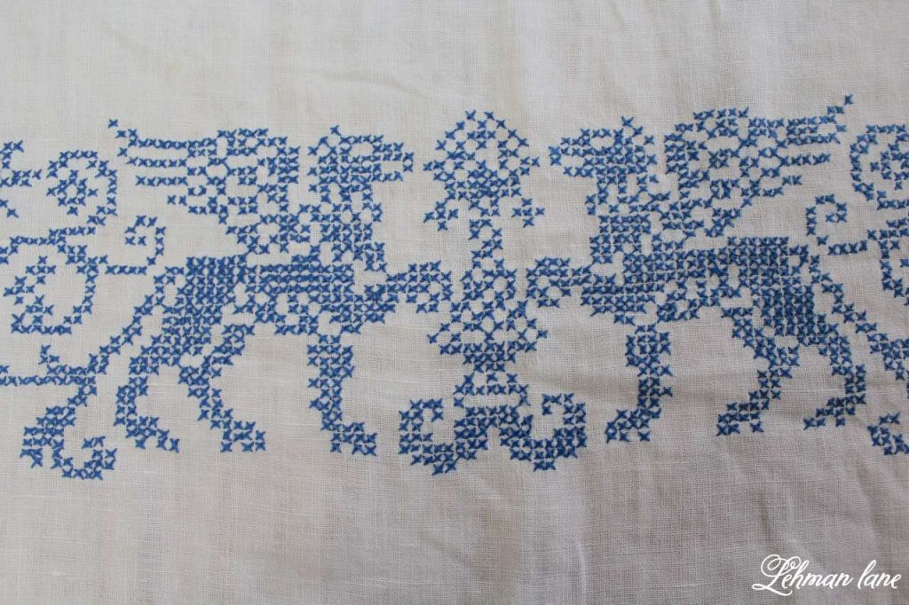 Decorating a Winter Table - vintage cross stitch tablecloth