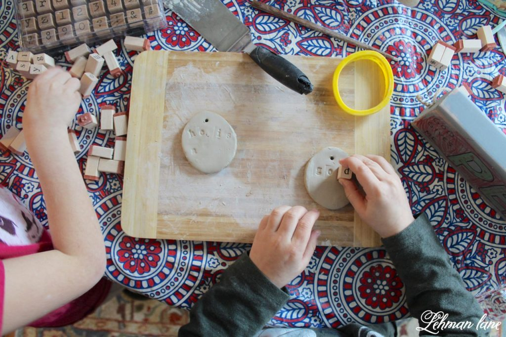 Stick Tree and Clay Ornaments for Easter - kids stamping