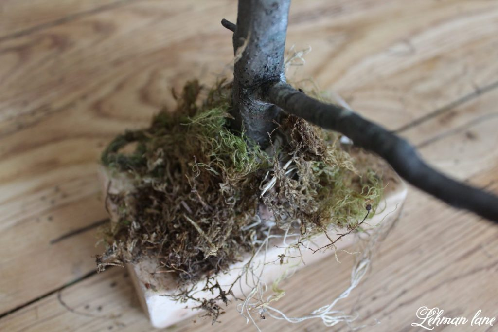 Stick Tree and Clay Ornaments for Easter - moss covering clay