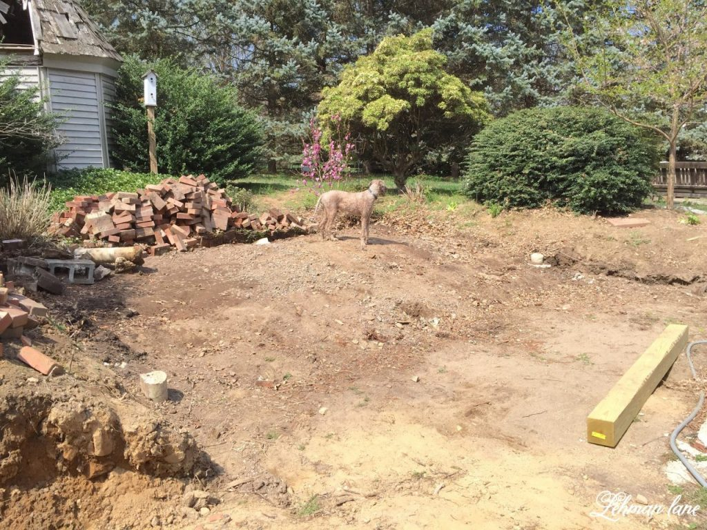 Back Patio - the plan and deck demo - deck gone - build a wood retaining wall