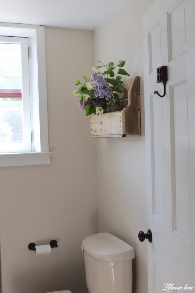 DIY Wood Pallet Shelf for Flowers - powder room