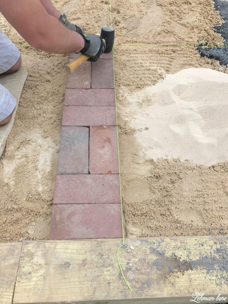 DIY Brick Patio - tamping down bricks