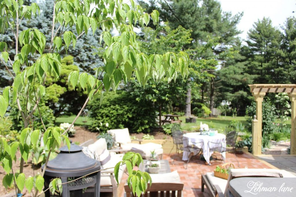 We transformed the backyard of our farmhouse by taking down a deck and creating a sunken brick and flagstone patio. Back Patio Makeover - Final Reveal / sunken patio / brick patio/ farmhouse backyard / patio makeover/ diy http://lehmanlane.net
