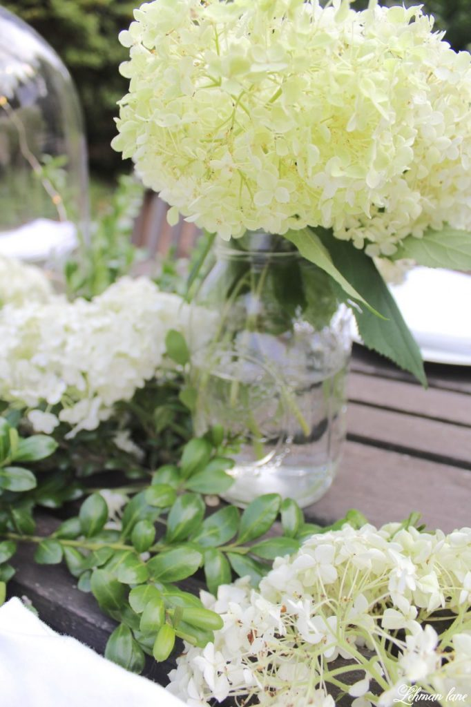 Outdoor Summer Tablescape on our backyard farmhouse patio for a fancy alfresco dinner! white hydrangea, ball jar