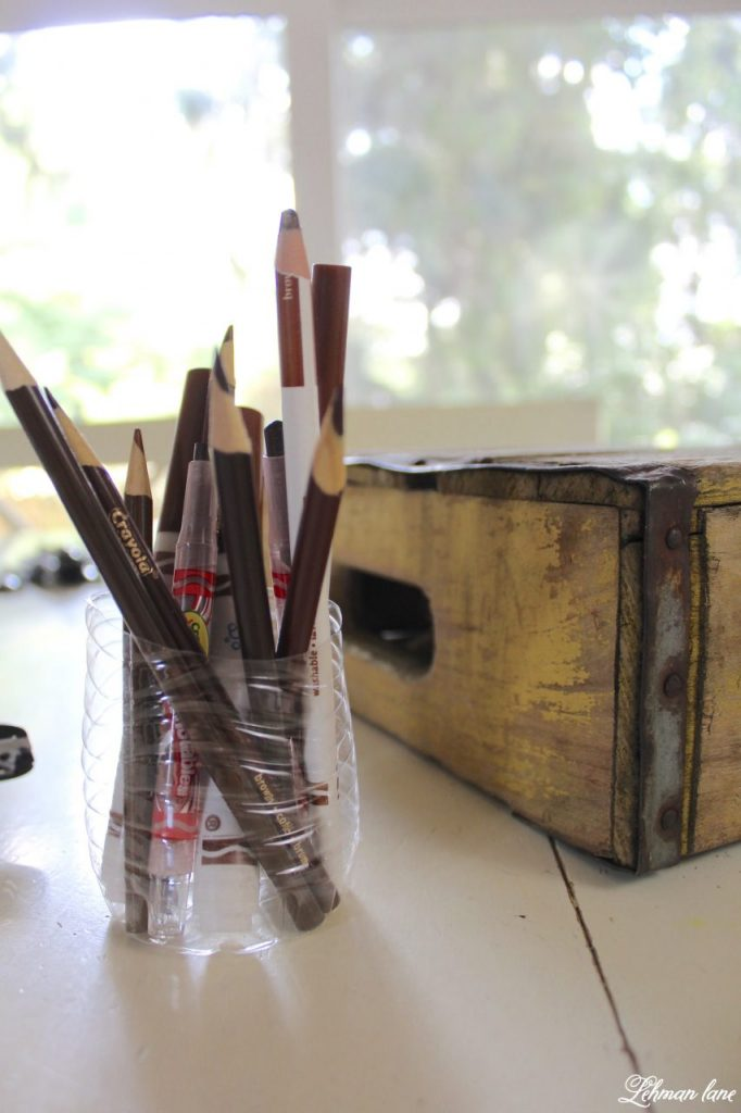 DIY Art Caddy from an Old Beverage Crate - Back to Basics and Back to School - water bottle in half