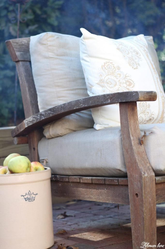 Stop by to see our fall patio and see even more beautiful outdoor spaces from my friends! #fall #falldecor #falloutdoors #fallpatio http://lehmanlane.net - apples in crock and chair