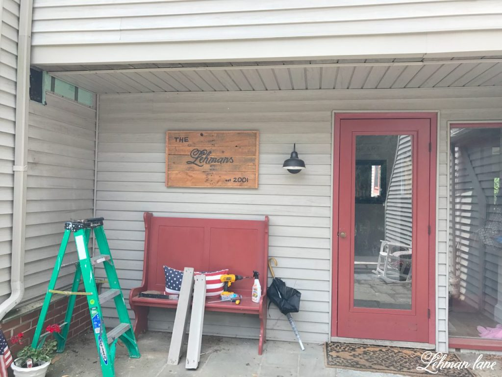 front porch pergola for our farmhouse - taking down the faux beam