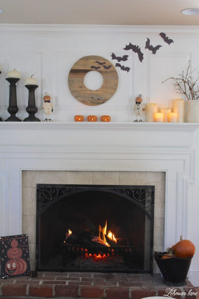 Halloween Mantel - pallet wreath, paper bats, candles, pumpkins
